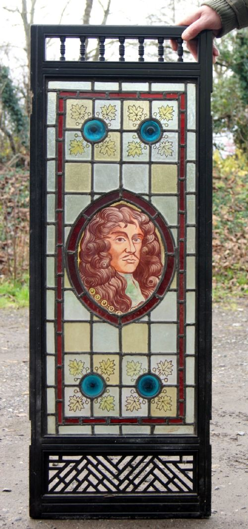 a stunning stained glass painted window with a portrait of charles 11